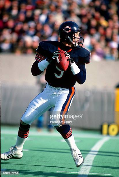Quarterback Jim McMahon of the Chicago Bears drops back to pass during an NFL football game at Soldier Field circa 1987 in Chicago Illinois McMahon...