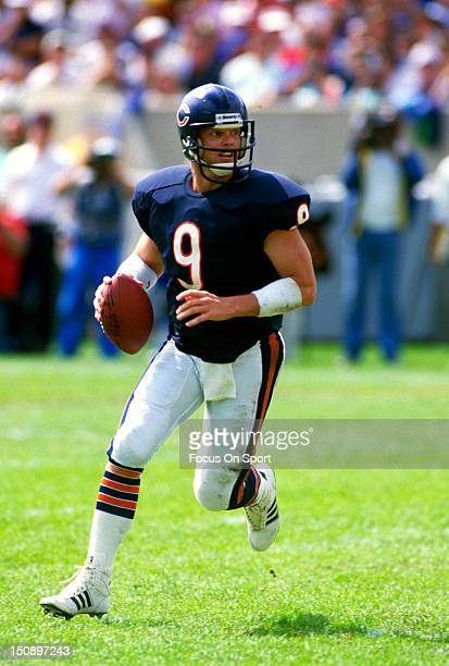 Quarterback Jim McMahon of the Chicago Bears rolls out to pass against the Miami Dolphins during an NFL football game at Soldier Field September 4...