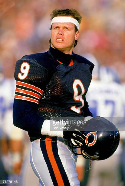 Quarterback Jim McMahon of the Chicago Bears stands on the sideline with his helmet off during the game against the Detroit Lions at Soldier Field on...