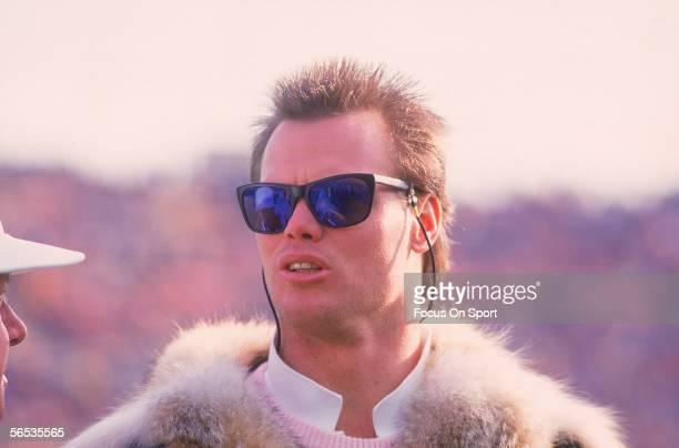 Quarterback Jim McMahon of the Chicago Bears talks to a friend