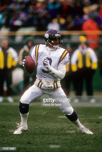 Quarterback Jim McMahon of the Minnesota Vikings drops back to pass against the Green Bay Packers December 19 1993 during an NFL football game at...