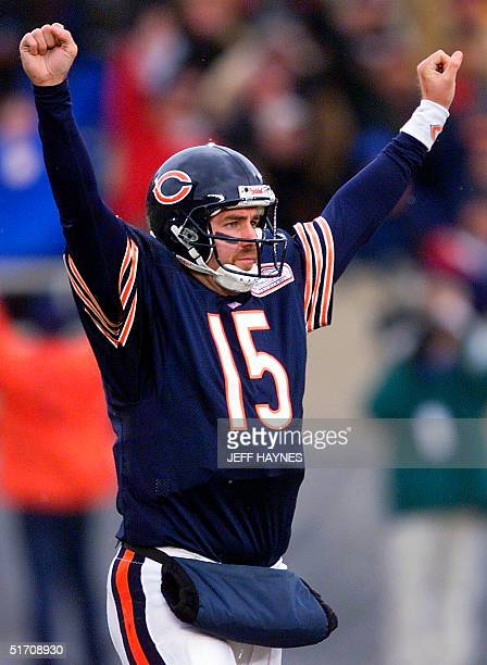 Quarterback Jim Miller of the Chicago Bears celebrates a touchdown run by Anthony Thomas against the Jacksonville Jaguars 06 January during the...