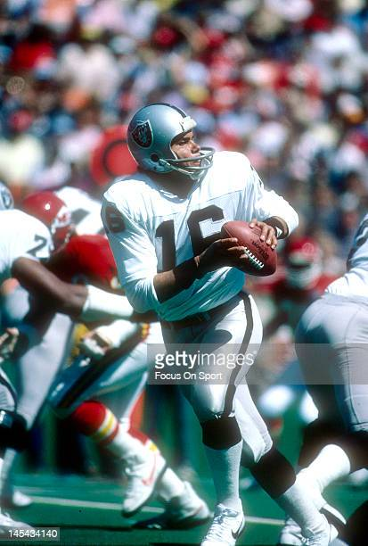 Quarterback Jim Plunkett of the Los Angeles Raiders drops back to pass against the Kansa City Chief during an NFL football gameSeptember 16 1984 at...