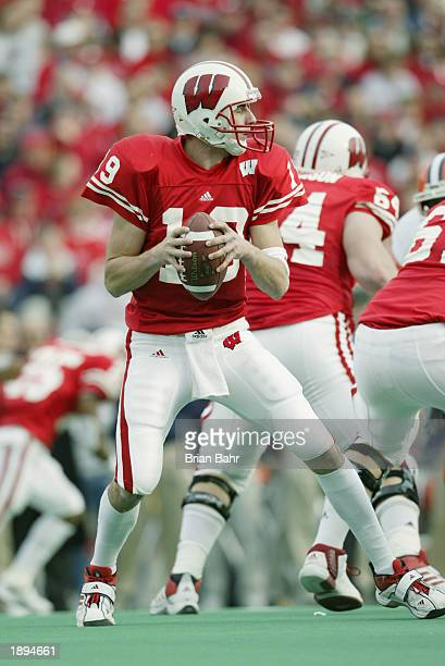 Quarterback Jim Sorgi of the UW Badgers looks for a receiver during the NCAA Big Ten Conference football game against the Fighting Illini at Camp...