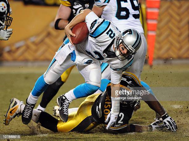 Quarterback Jimmy Clausen of the Carolina Panthers scrambles against linebacker James Harrison of the Pittsburgh Steelers during a game at Heinz...