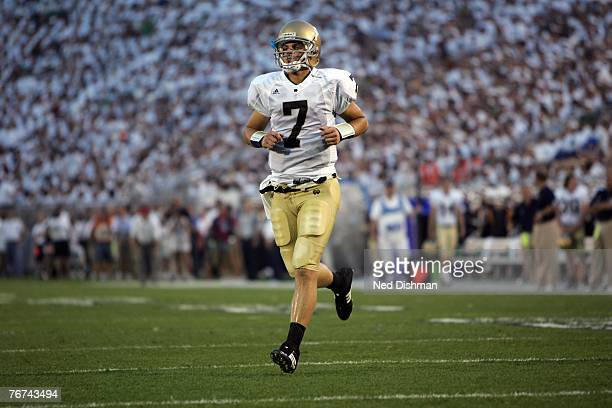 Quarterback Jimmy Clausen of the University of Notre Dame Fighting Irish runs onto the field against the Penn State Nittany Lions at Beaver Stadium...