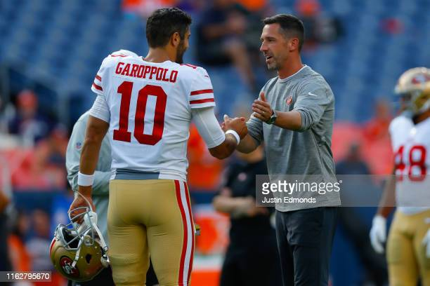 Quarterback Jimmy Garoppolo and head coach Kyle Shanahan of the San Francisco 49ers shake hands before a preseason game against the Denver Broncos at...