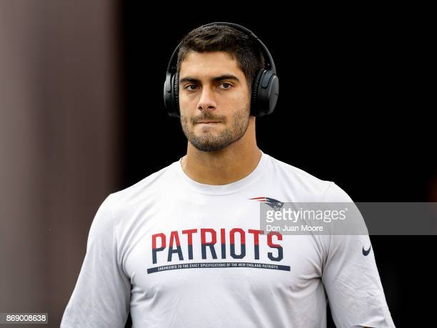 Quarterback Jimmy Garoppolo of the New England Patriots enters the field for pregame warmups with a pair of BOSE headphones on before the game...