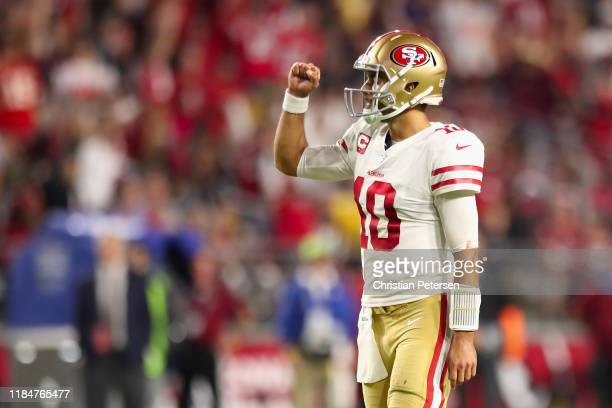 Quarterback Jimmy Garoppolo of the San Francisco 49ers celebrates after throwing a 21 yard touchdown reception to Dante Pettis during the second half...