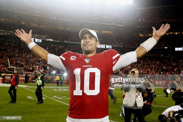 Quarterback Jimmy Garoppolo of the San Francisco 49ers celebrates a win against the Los Angeles Rams at Levi's Stadium on December 21, 2019 in Santa...