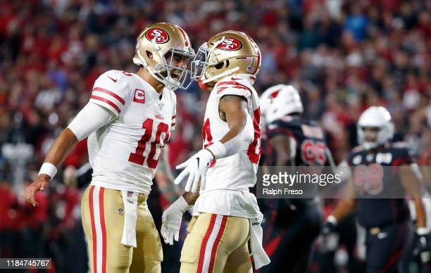 Quarterback Jimmy Garoppolo of the San Francisco 49ers celebrates with receiver Kendrick Bourne after Bourne's touchdown catch against the Arizona...