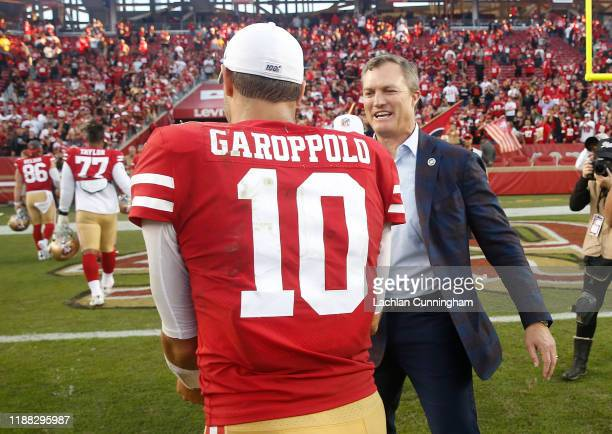 Quarterback Jimmy Garoppolo of the San Francisco 49ers is congratulated by General Manager John Lynch after the team's win against the Arizona...