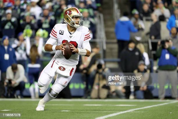 Quarterback Jimmy Garoppolo of the San Francisco 49ers looks to pass against the Seattle Seahawks during the game at CenturyLink Field on December 29...