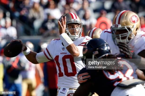 Quarterback Jimmy Garoppolo of the San Francisco 49ers looks to pass the football in the first quarter against the Chicago Bears at Soldier Field on...
