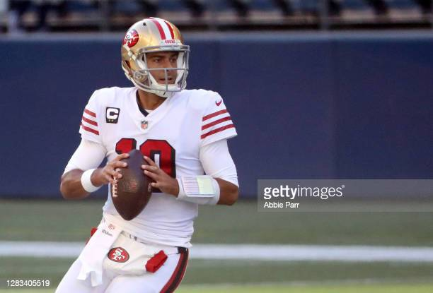 Quarterback Jimmy Garoppolo of the San Francisco 49ers looks to throw the ball against the Seattle Seahawks in the first quarter of the game at...