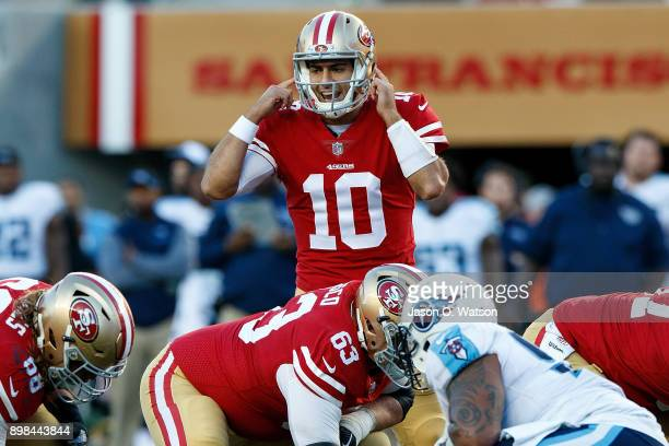 Quarterback Jimmy Garoppolo of the San Francisco 49ers signals behind the line of scrimmage during the fourth quarter against the Tennessee Titans at...