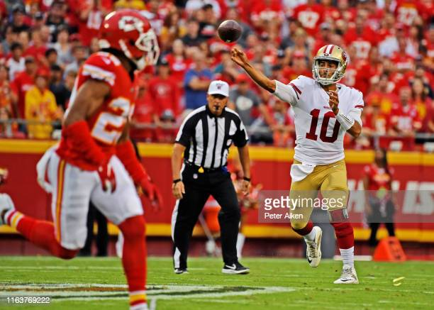 Quarterback Jimmy Garoppolo of the San Francisco 49ers throws a pass down field during the first half of a preseason game against the Kansas City...