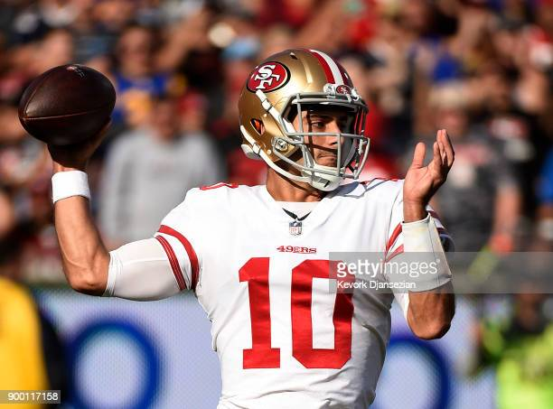 Quarterback Jimmy Garoppolo of the San Francisco 49ers throws a pass Los Angeles Rams during the first quarter at Los Angeles Memorial Coliseum on...