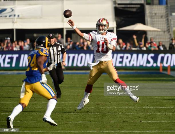 Quarterback Jimmy Garoppolo of the San Francisco 49ers throws a pass against Blake Countess of the Los Angeles Rams during the second quarter at Los...