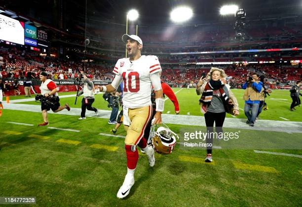 Quarterback Jimmy Garoppolo of the San Francisco 49ers walks off the field following the NFL football game against the Arizona Cardinals at State...