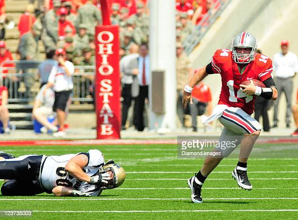 Quarterback Joe Bauserman of the Ohio State University avoids the tackle from Dan Marcoux of the University of Akron during a game with the Akron...