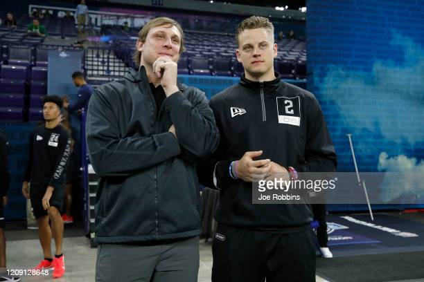 Quarterback Joe Burrow of LSU talks to former NFL quarterback Chad Pennington during NFL Scouting Combine at Lucas Oil Stadium on February 27 2020 in...