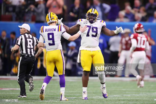 Quarterback Joe Burrow of the LSU Tigers and center Lloyd Cushenberry III of the LSU Tigers celebrate a touchdown in the second quarter over the...
