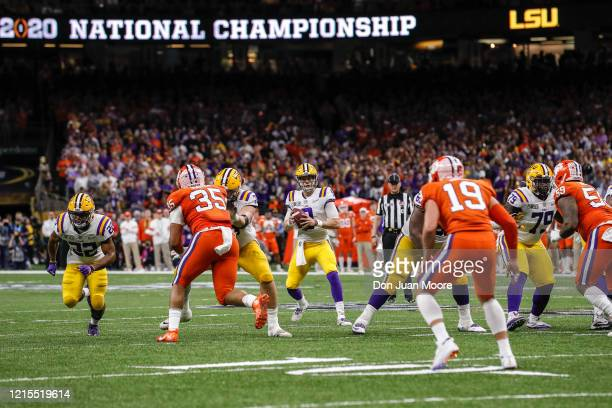 Quarterback Joe Burrow of the LSU Tigers fade back for a pass during the College Football Playoff National Championship game against the Clemson...