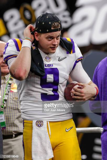 Quarterback Joe Burrow of the LSU Tigers on stage after the College Football Playoff National Championship game against the Clemson Tigers at the...