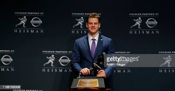 Quarterback Joe Burrow of the LSU Tigers winner of the 85th annual Heisman Memorial Trophy poses for photos on December 14 2019 at the Marriott...