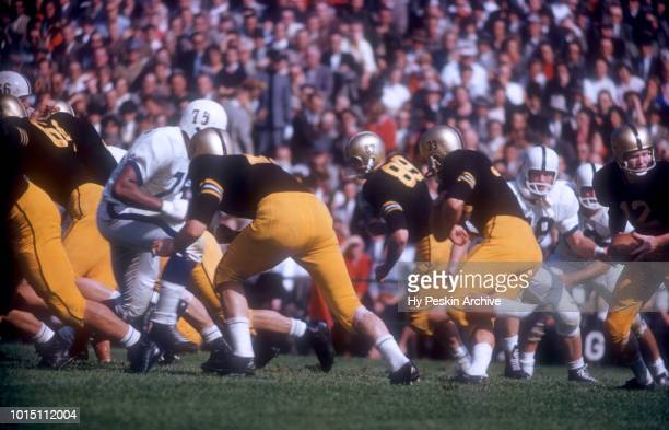 Quarterback Joe Caldwell of the Army Cadets fakes the hand off to Harry Walters during an NCAA game against the Penn State Nittany Lions on October 4...