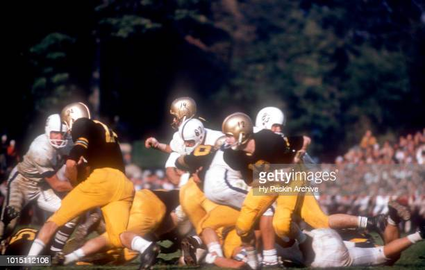 Quarterback Joe Caldwell of the Army Cadets hands the ball off to Pete Dawkins during an NCAA game against the Penn State Nittany Lions on October 4...