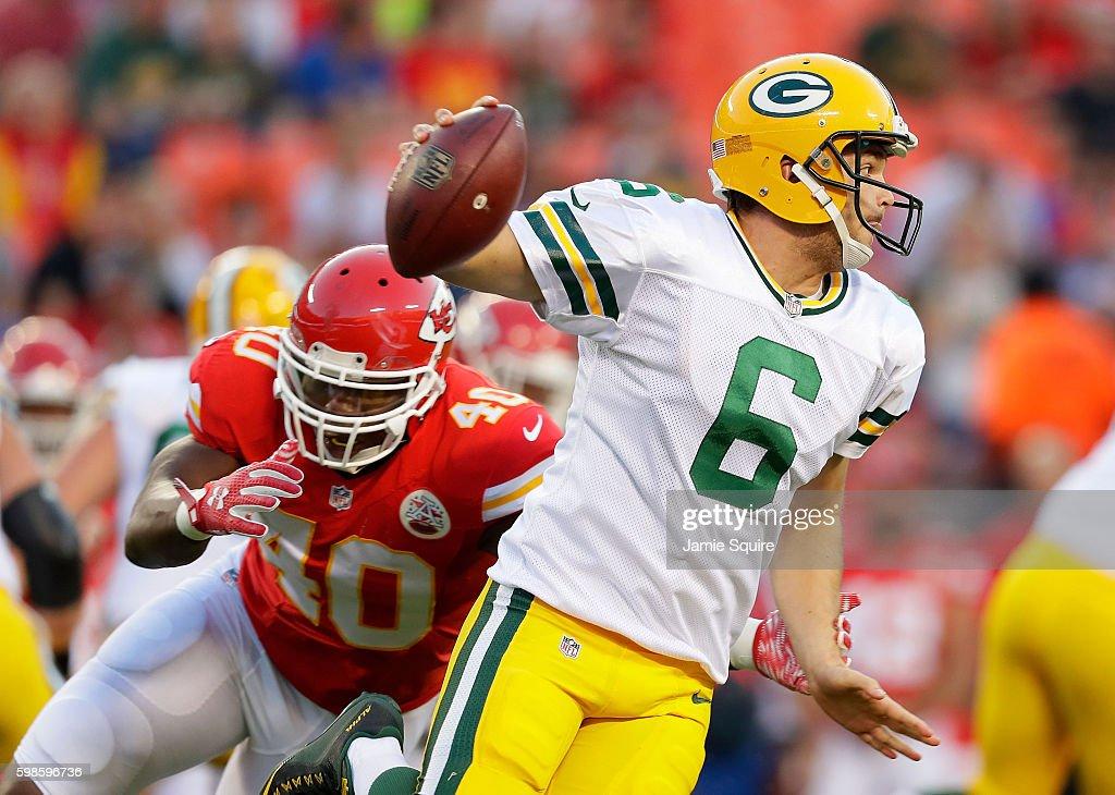 Quarterback Joe Callahan #6 of the Green Bay Packers scrambles as Trey Millard #40 of the Kansas City Chiefs chases during the preseason game at Arrowhead Stadium on September 1, 2016 in Kansas City, Missouri.