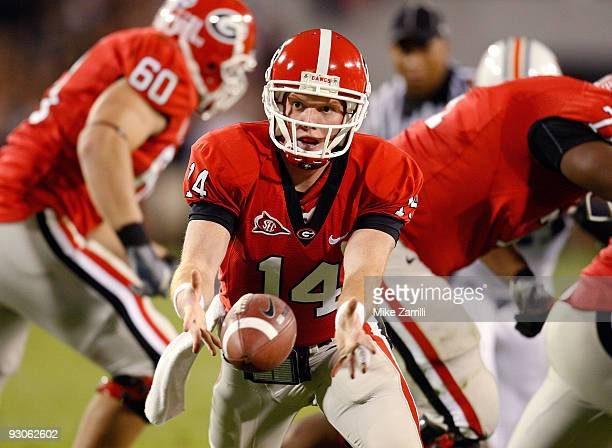 Quarterback Joe Cox of the Georgia Bulldogs pitches the ball back to a running back during the game against the Auburn Tigers at Sanford Stadium on...