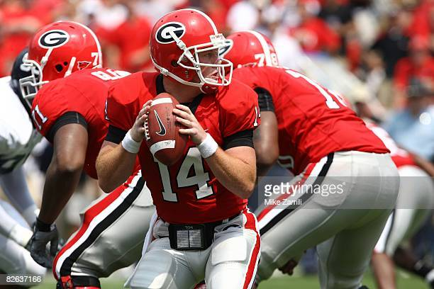 Quarterback Joe Cox of the Georgia Bulldogs takes a snap and looks to hand the ball off during the game against the Georgia Southern Eagles at...