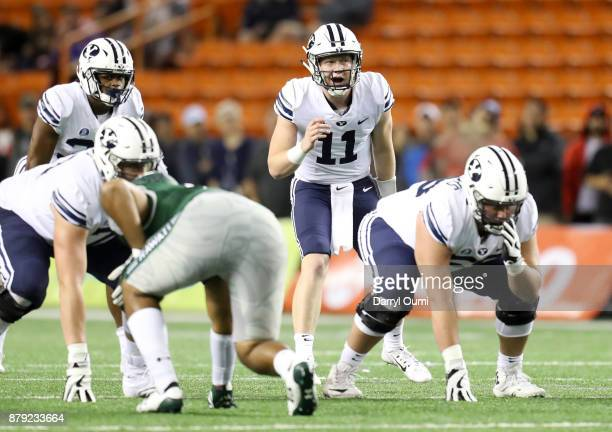Quarterback Joe Critchlow of the BYU Cougars calls an audible at the line during the second half of the game against the Hawaii Rainbow Warriors at...
