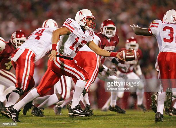 Quarterback Joe Dailey of the University of Nebraska Cornhuskers looks to hand off the ball against the University of Oklahoma Sooners during the...