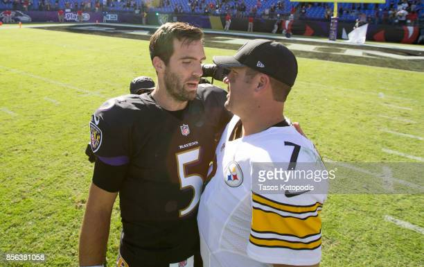 Quarterback Joe Flacco of the Baltimore Ravens and Quarterback Ben Roethlisberger of the Pittsburgh Steelers chat after the game at MT Bank Stadium...