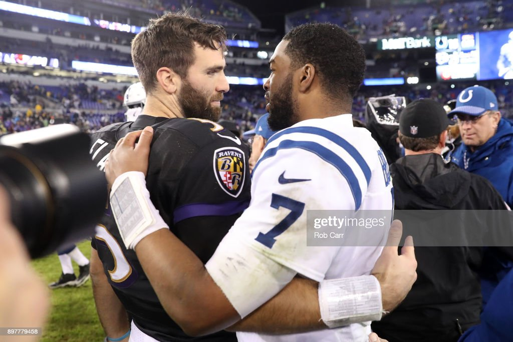 Quarterback Joe Flacco #5 of the Baltimore Ravens and quarterback Jacoby Brissett #7 of the Indianapolis Colts hug after the Baltimore Ravens 23-16 win over the Indianapolis Colts at M&T Bank Stadium on December 23, 2017 in Baltimore, Maryland.