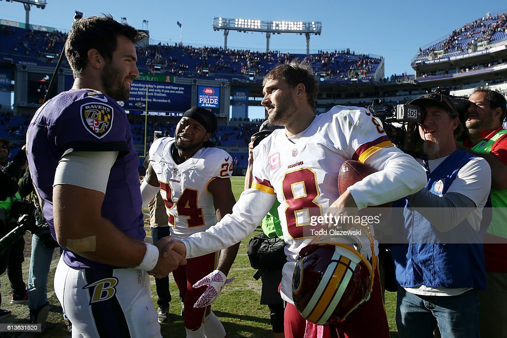 Quarterback Joe Flacco #5 of the Baltimore Ravens and quarterback Kirk Cousins #8 of the Washington Redskins shake hands after the game at M&T Bank Stadium on October 9, 2016 in Baltimore, Maryland.