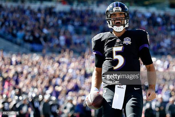 Quarterback Joe Flacco of the Baltimore Ravens celebrates after scoring a first quarter touchdown during a game against the Cleveland Browns at MT...