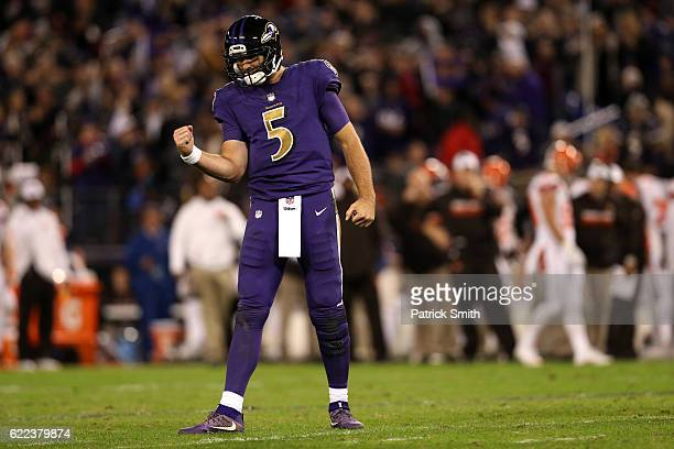 Quarterback Joe Flacco of the Baltimore Ravens celebrates after throwing a touchdown pass to wide receiver Chris Matthews against the Cleveland...
