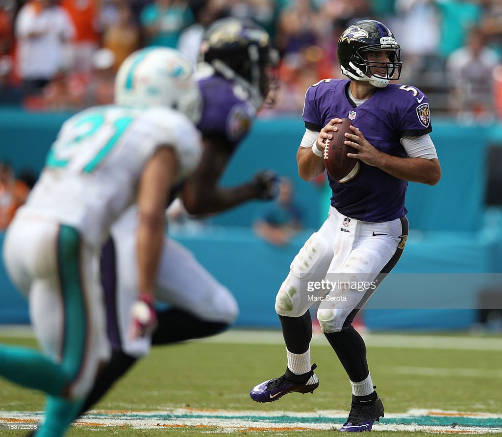 Quarterback Joe Flacco #5 of the Baltimore Ravens drops back against the Miami Dolphins at Sun Life Stadium on October 6, 2013 in Miami Gardens, Florida. The Ravens defeated the Dolphins 26-23.