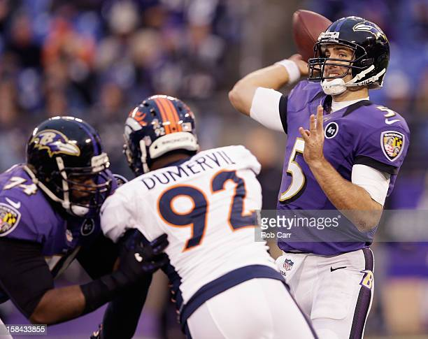 Quarterback Joe Flacco of the Baltimore Ravens gets off a pass while tackle Michael Oher blocks defensive end Elvis Dumervil of the Denver Broncos...