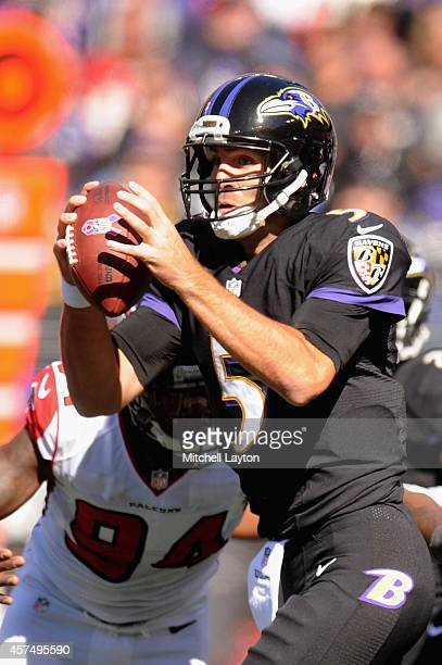 Quarterback Joe Flacco of the Baltimore Ravens is pressured by outside linebacker Jonathan Massaquoi of the Atlanta Falcons in the first half at MT...