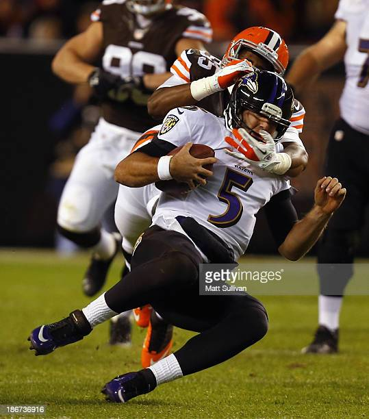 Quarterback Joe Flacco of the Baltimore Ravens is sacked by defensive lineman Armonty Bryant of the Cleveland Browns at FirstEnergy Stadium on...