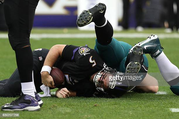 Quarterback Joe Flacco of the Baltimore Ravens is sacked by defensive tackle Beau Allen of the Philadelphia Eagles in the first quarter at M&T Bank...