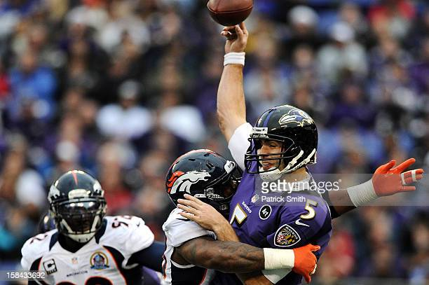 Quarterback Joe Flacco of the Baltimore Ravens is sacked by linebacker Von Miller of the Denver Broncos in the third quarter at MT Bank Stadium on...