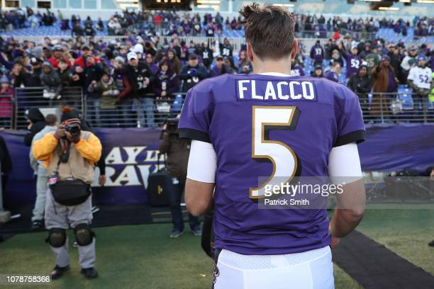 Quarterback Joe Flacco of the Baltimore Ravens looks on after losing the Los Angeles Chargers in the AFC Wild Card Playoff game at MT Bank Stadium on...