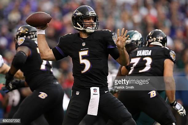 Quarterback Joe Flacco of the Baltimore Ravens passes the ball while teammate guard Marshal Yanda of the Baltimore Ravens blocks against the...